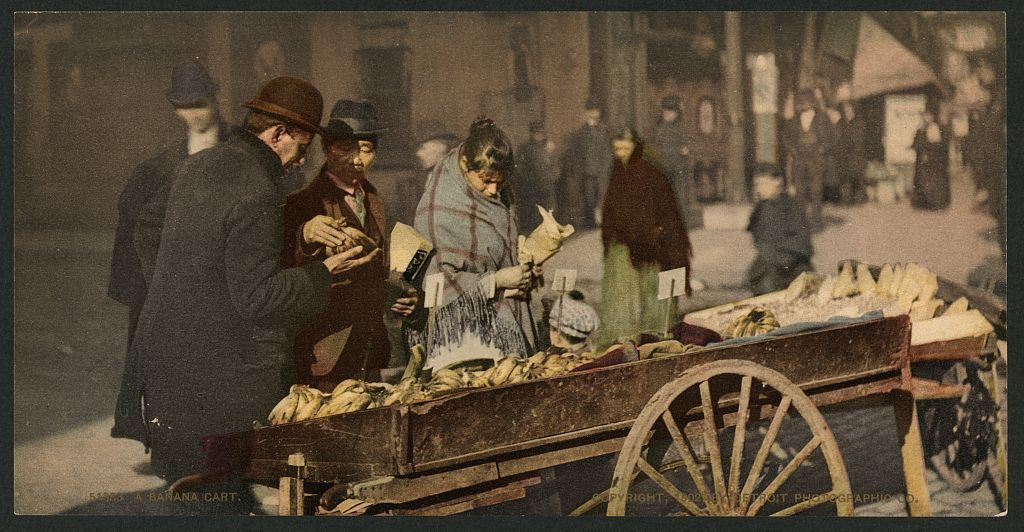 A colorized 1902 photograph shows a banana cart in Detroit